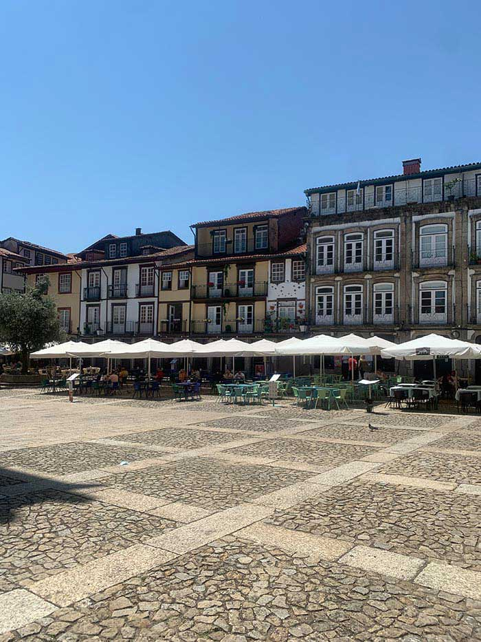One of the big squares in Guimaraes, Portugal   40plusstyle.com