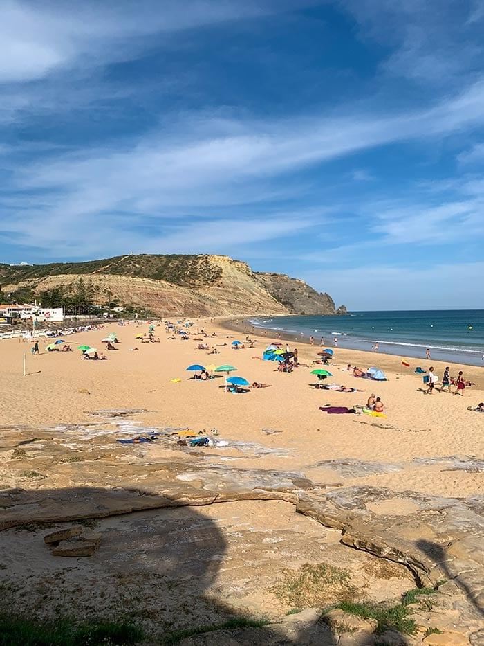 People enjoying Praia da Luz beach   40plusstyle.com