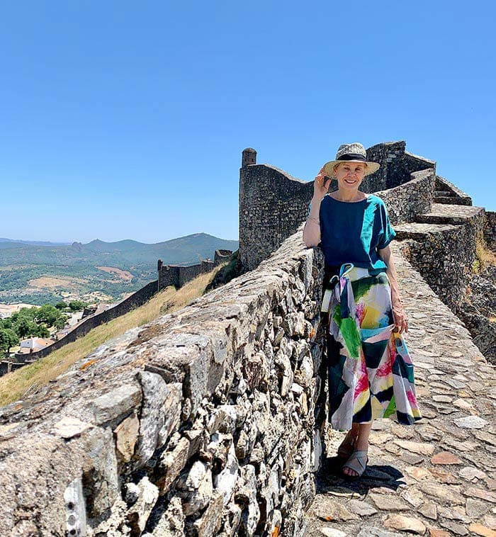 Wearing a colorful skirt in Portugal | 40plusstyle.com