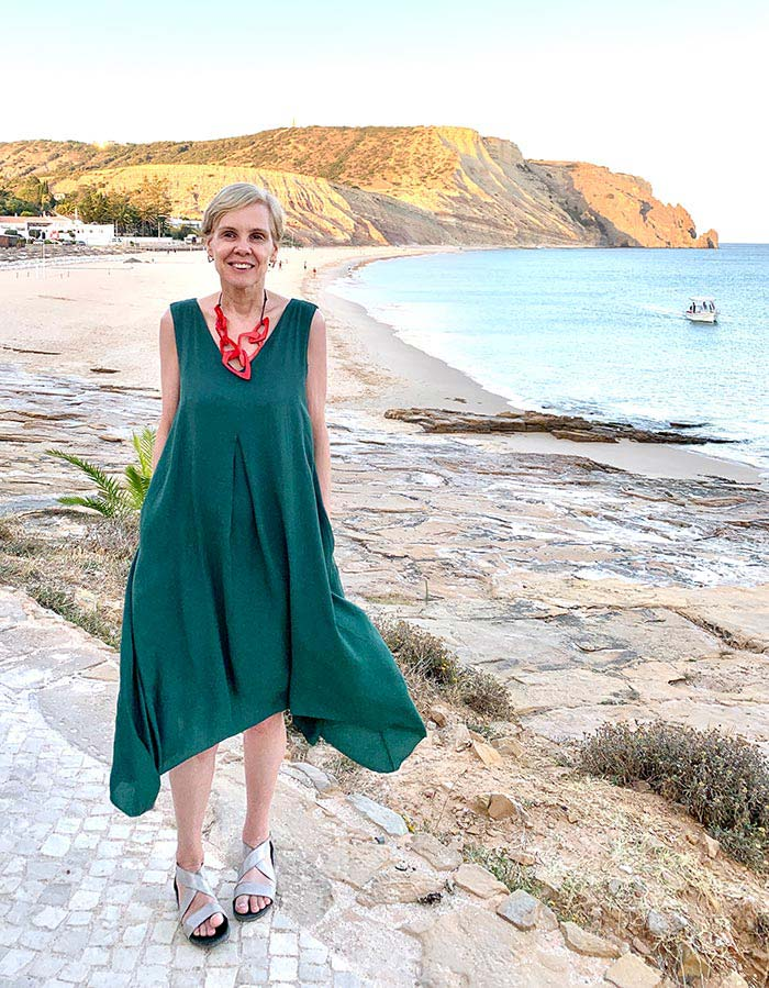 Wearing a green dress in Luz, Portugal