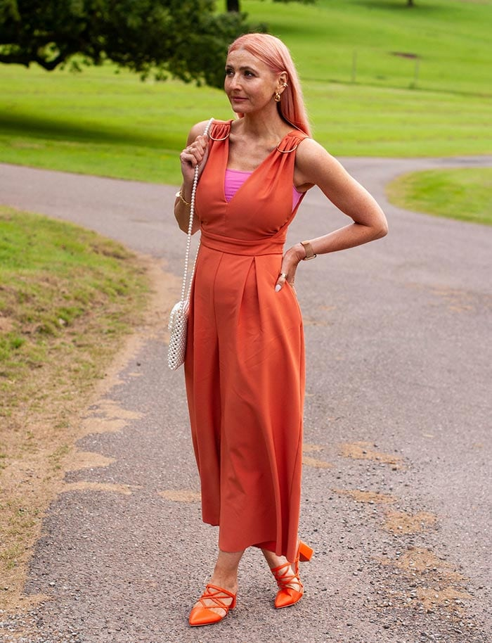 Romantic style - Catherine wears orange and pink | 40plusstyle.com