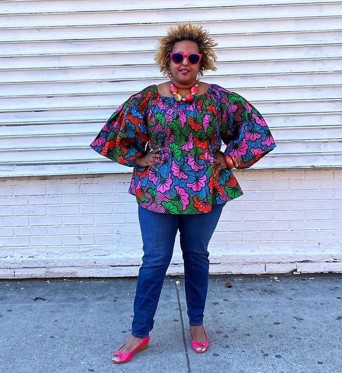 How to dress when you have a large bust - Lydia wears a print top and necklace   40plusstyle.com