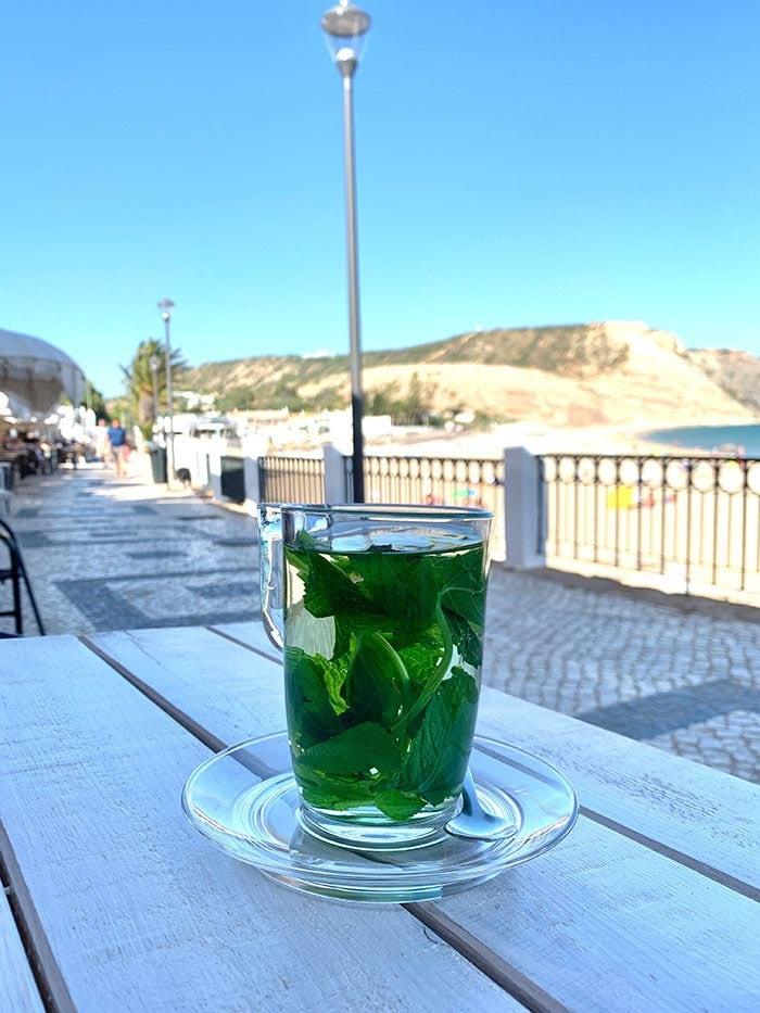 Sipping mint tea on the main boulevard in Praia da Luz, Portugal   40plusstyle.com