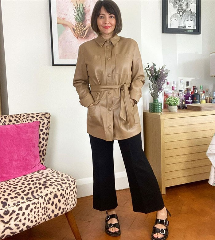 Nikki wears a belted leather jacket | 40plusstyle.com
