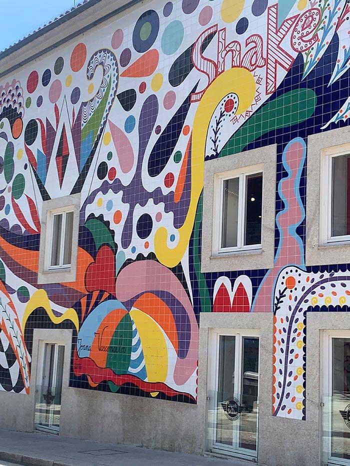 Colorful wall art in Porto Portugal   40plusstyle.com