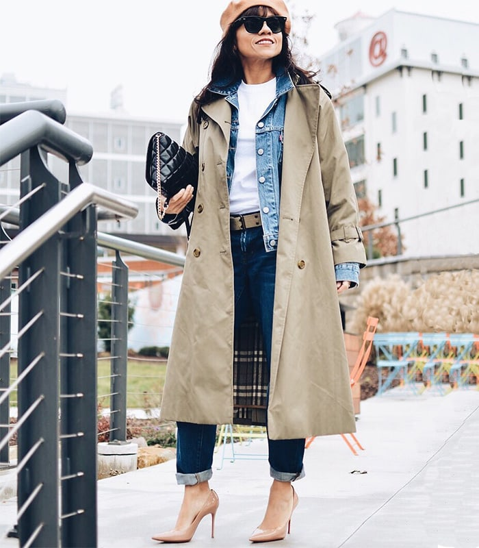Carelia wears her trench coat over a denim jacket | 40plusstyle.com