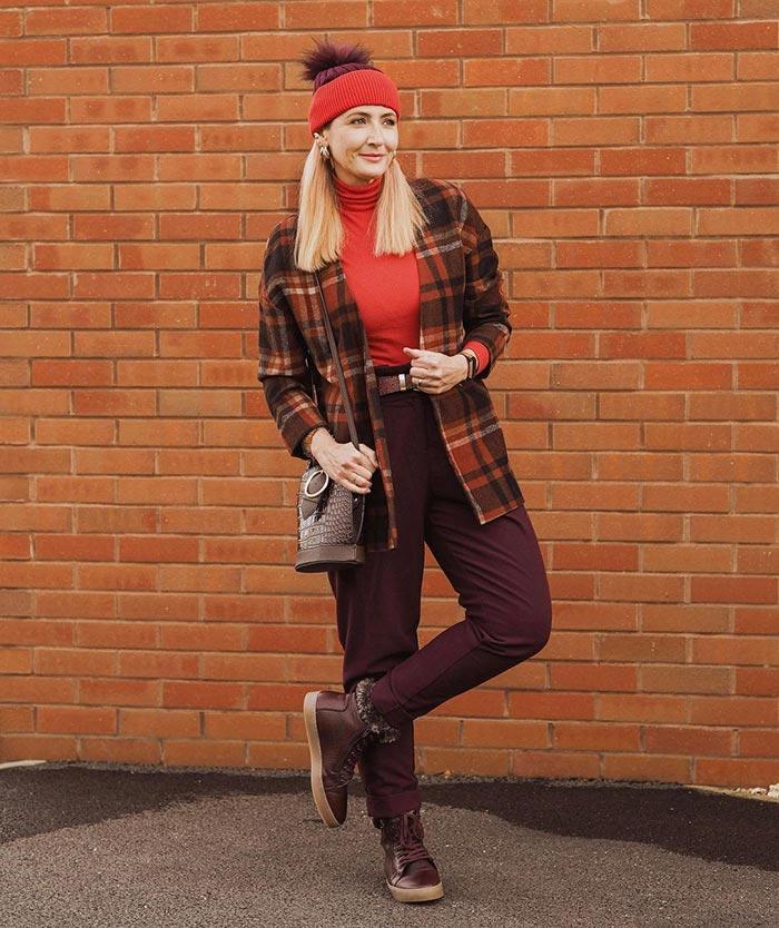 Best winter boots for women - Catherine wears sneaker boots   40plusstyle.com