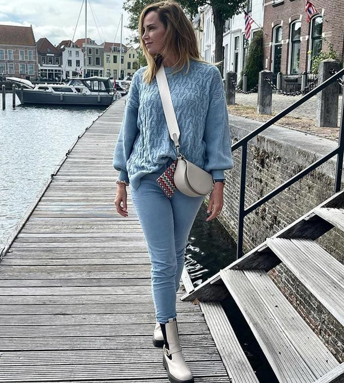 Jeans worn with white boots | 40plusstyle.com