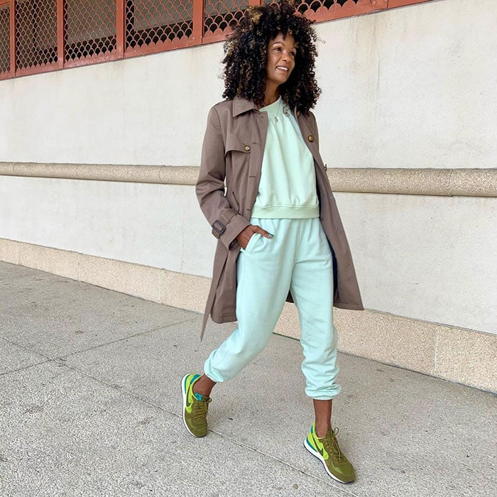 Diane wears her trench coat with jogging bottoms | 40plusstyle.com