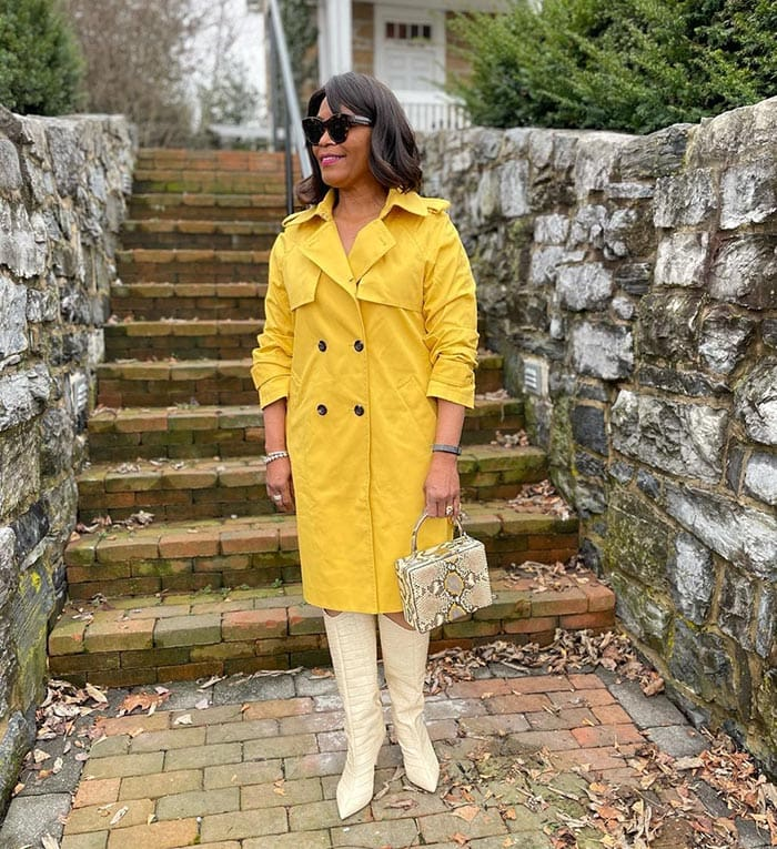 Eugenia wears cream boots with her yellow coat   40plusstyle.com