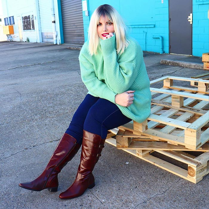 Mel wears knee-length boots with her jeans   40plusstyle.com