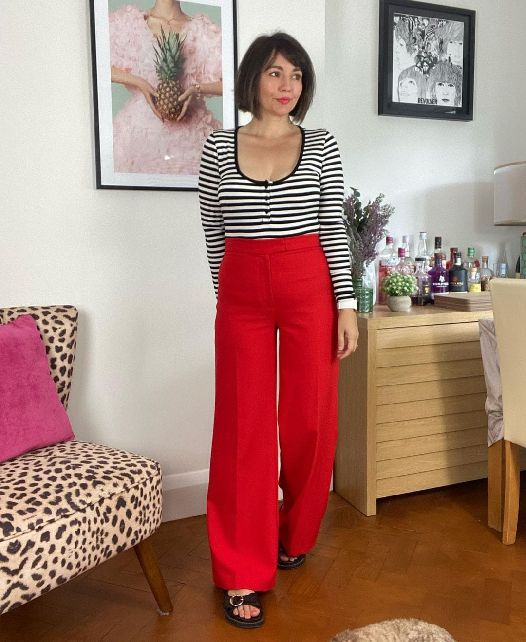 Nikkie in red pants and a striped top | 40plusstyle.com