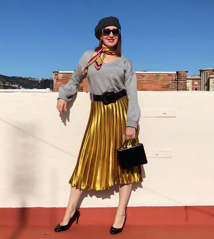 Patricia in a black beret and gold skirt | 40plusstyle.com