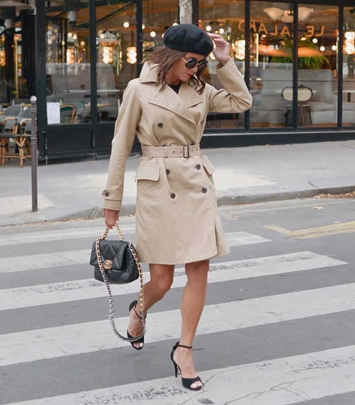 Sylvia wears a trench coat and beret | 40plusstyle.com